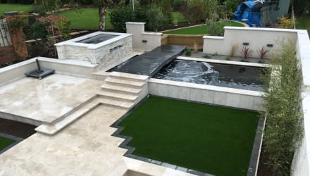 Multi-level patio with a koi pond