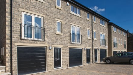 Dark grey and buff walling used on new housing.