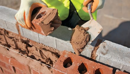Mortar being used on bricks
