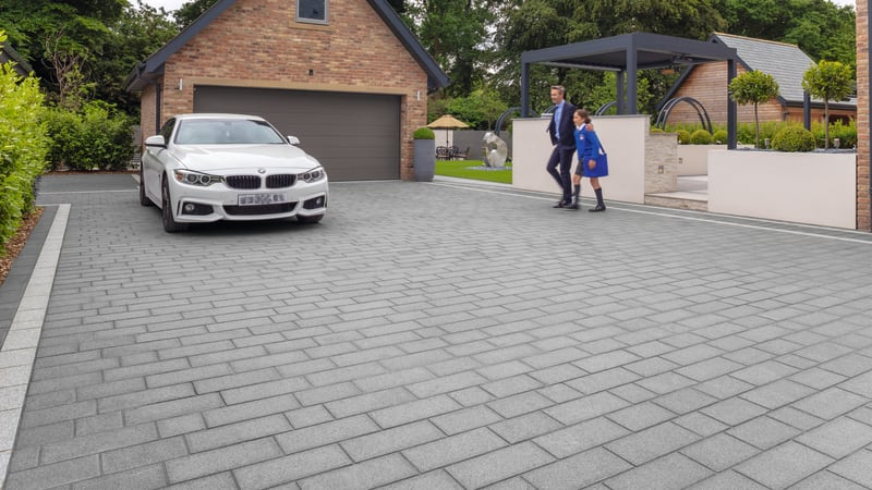 Grey granite driveway outside modern home