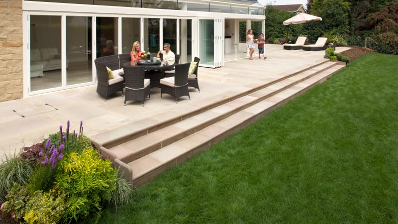 Marshalls Sawn Versuro Jumbo garden paving laid in a patio area.