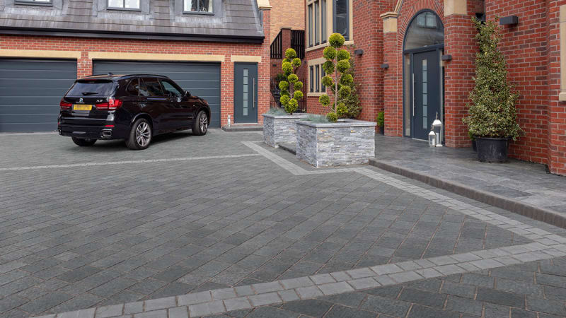 Marshalls Drivesys Flamed block paving laid in a driveway.