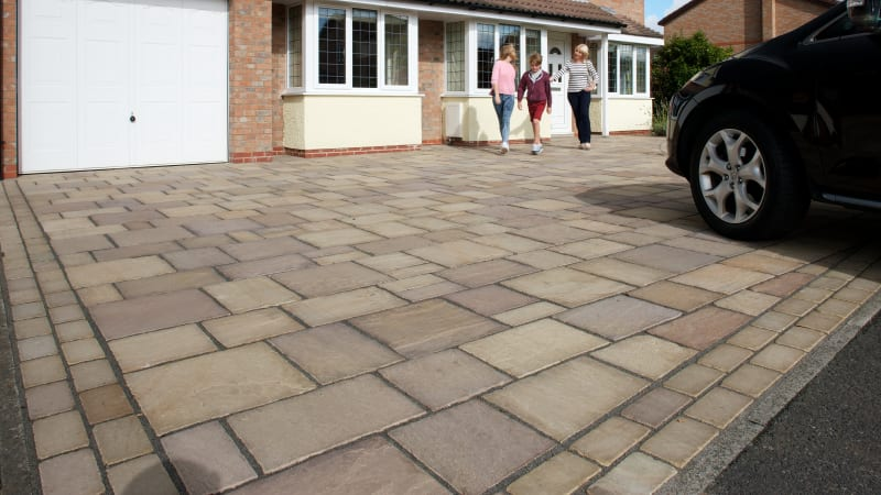 Marshalls Magnasetts in Autumn Gold laid on a driveway.