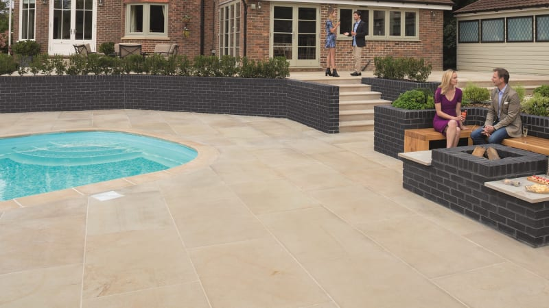 Marshalls Sawn Versuro King Size paving laid in a garden.