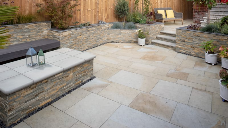 Marshalls Scoutmoor garden paving in Diamond Sawn and Stoneface Drystack walling in harvest