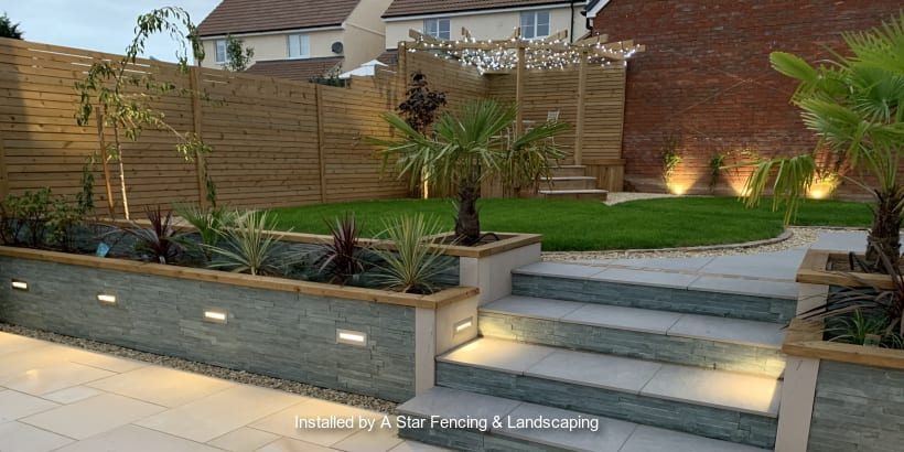 Brown fencing displayed on a beautiful modern garden patio.