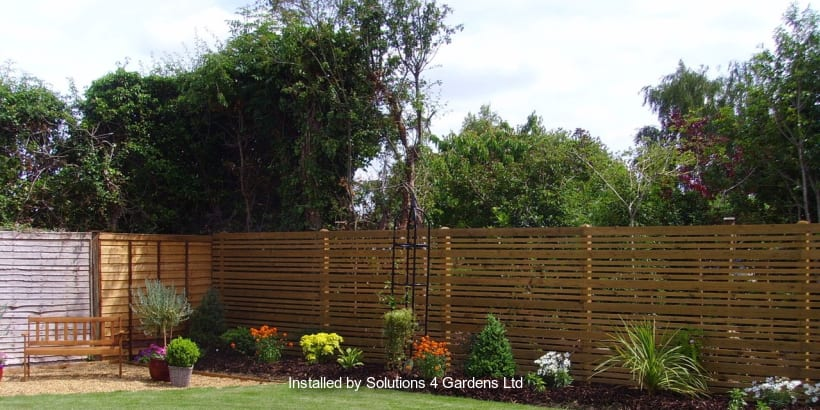 Fencing displayed in a garden area.