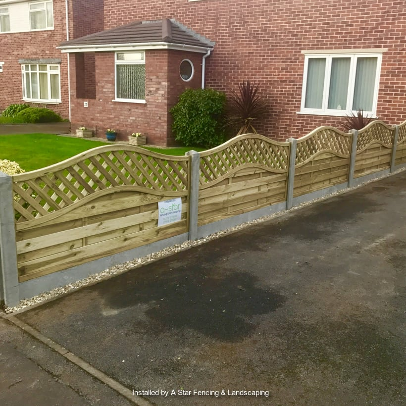 Light brown fencing placed on a driveway.