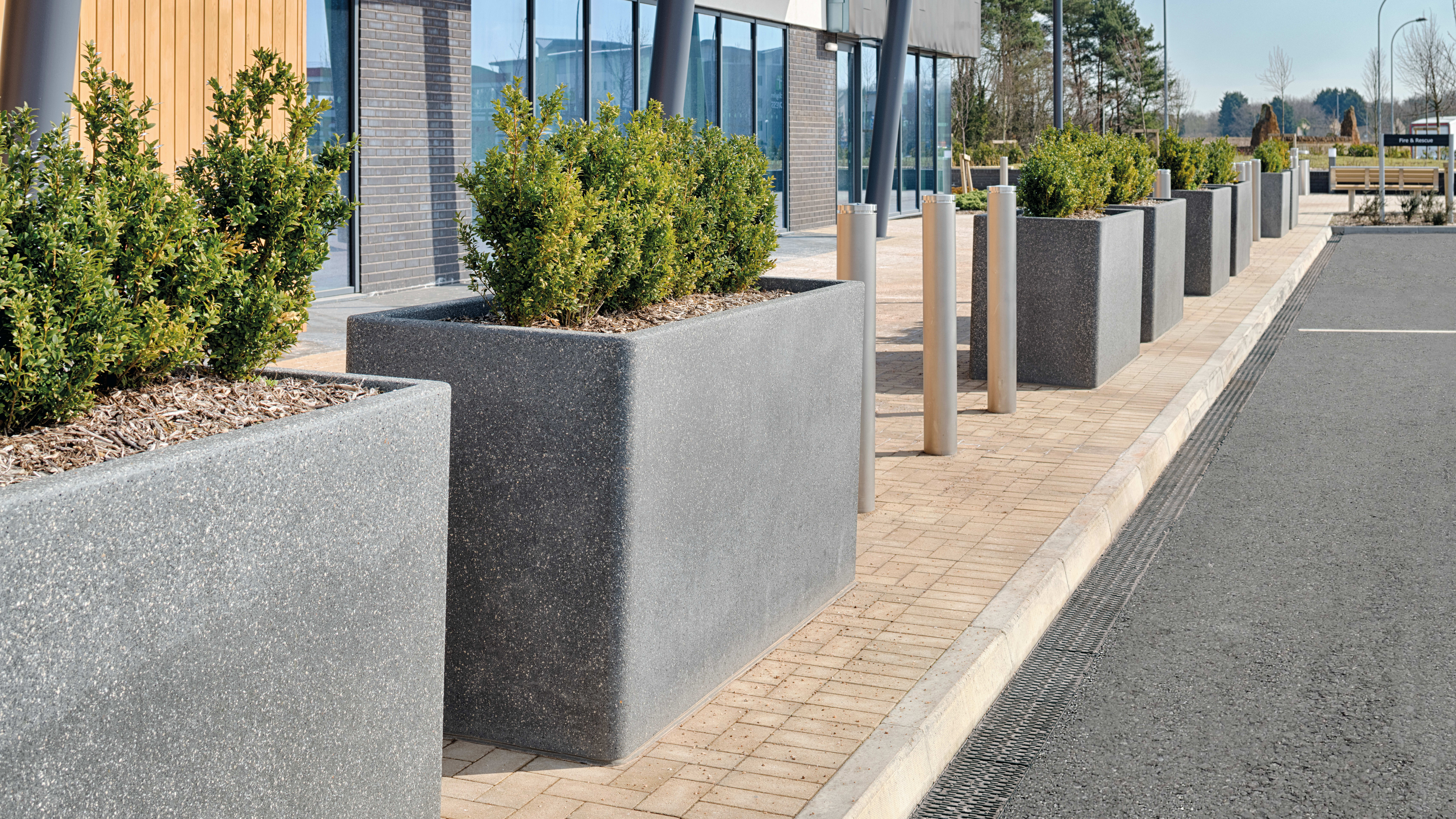 Grey Rhinoguard concrete palnters with Geo bollards
