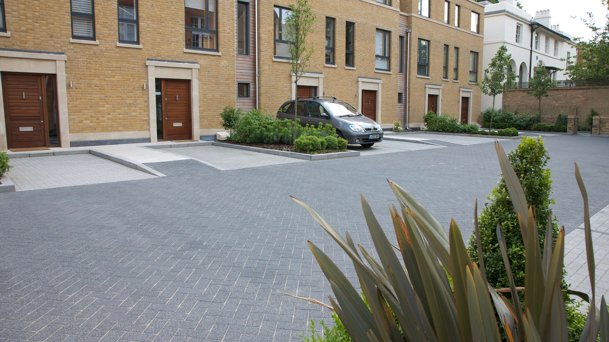 La Linia paving outside housing.