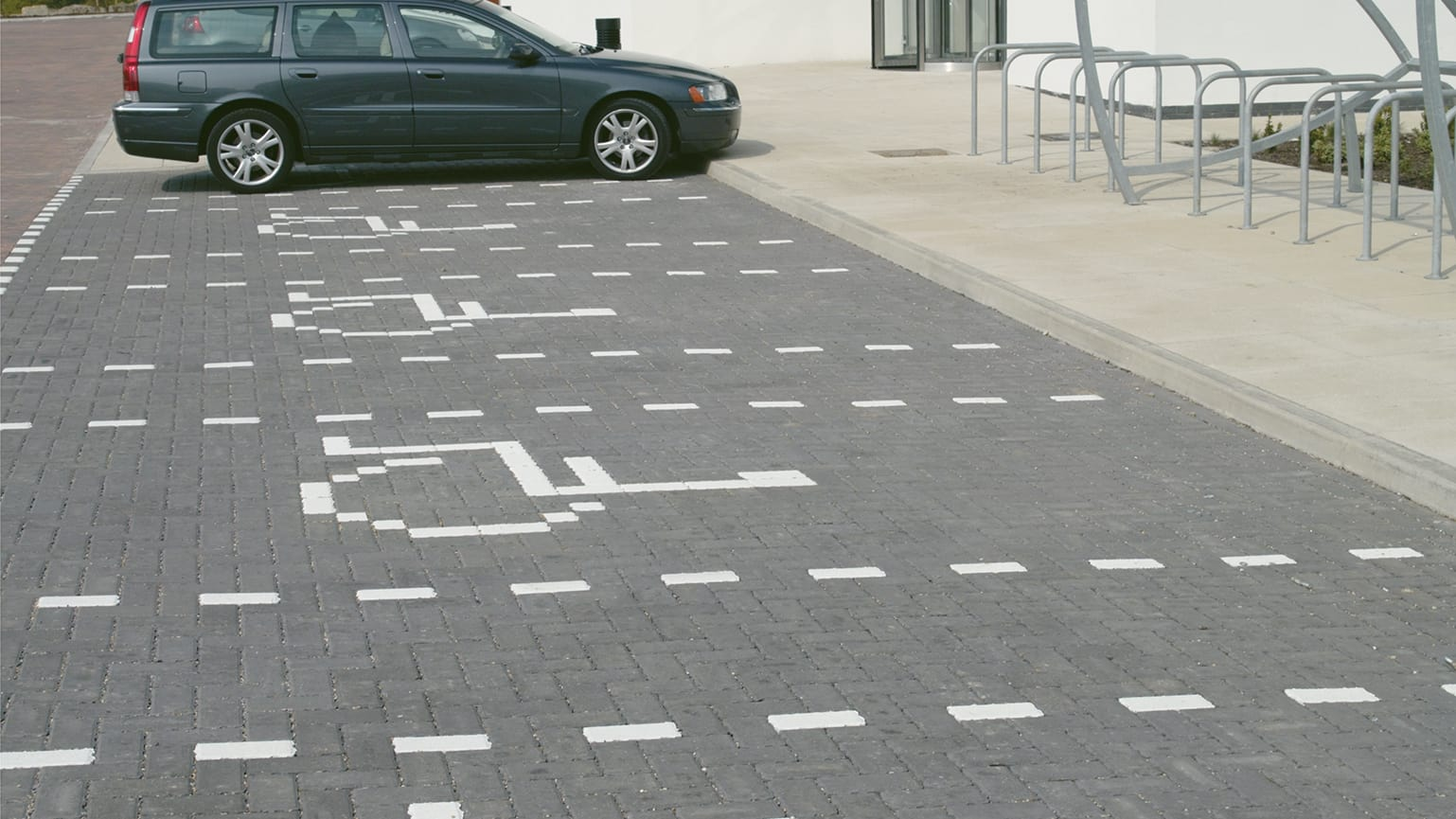 White marker blocks used to outline car spaces inside car park.