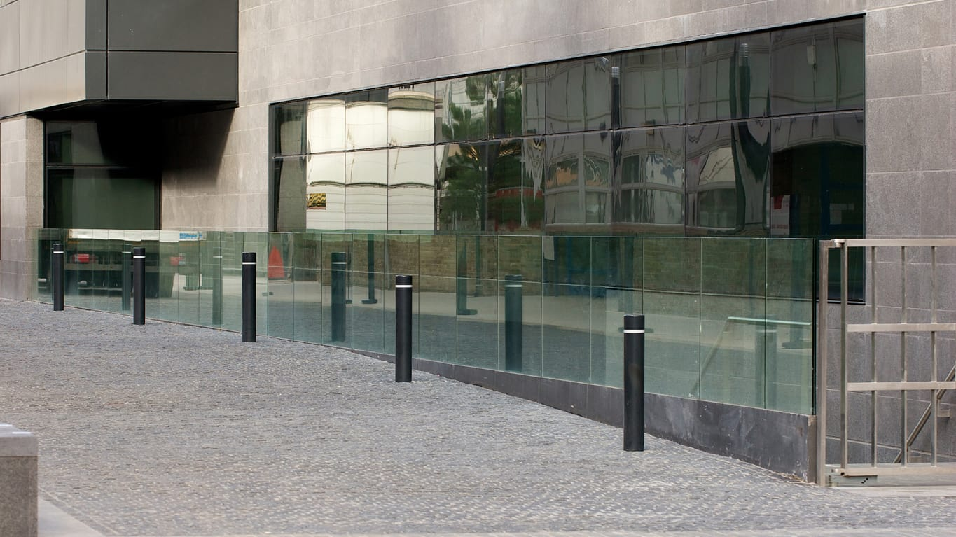 bollards outside the entrance of a commercial building