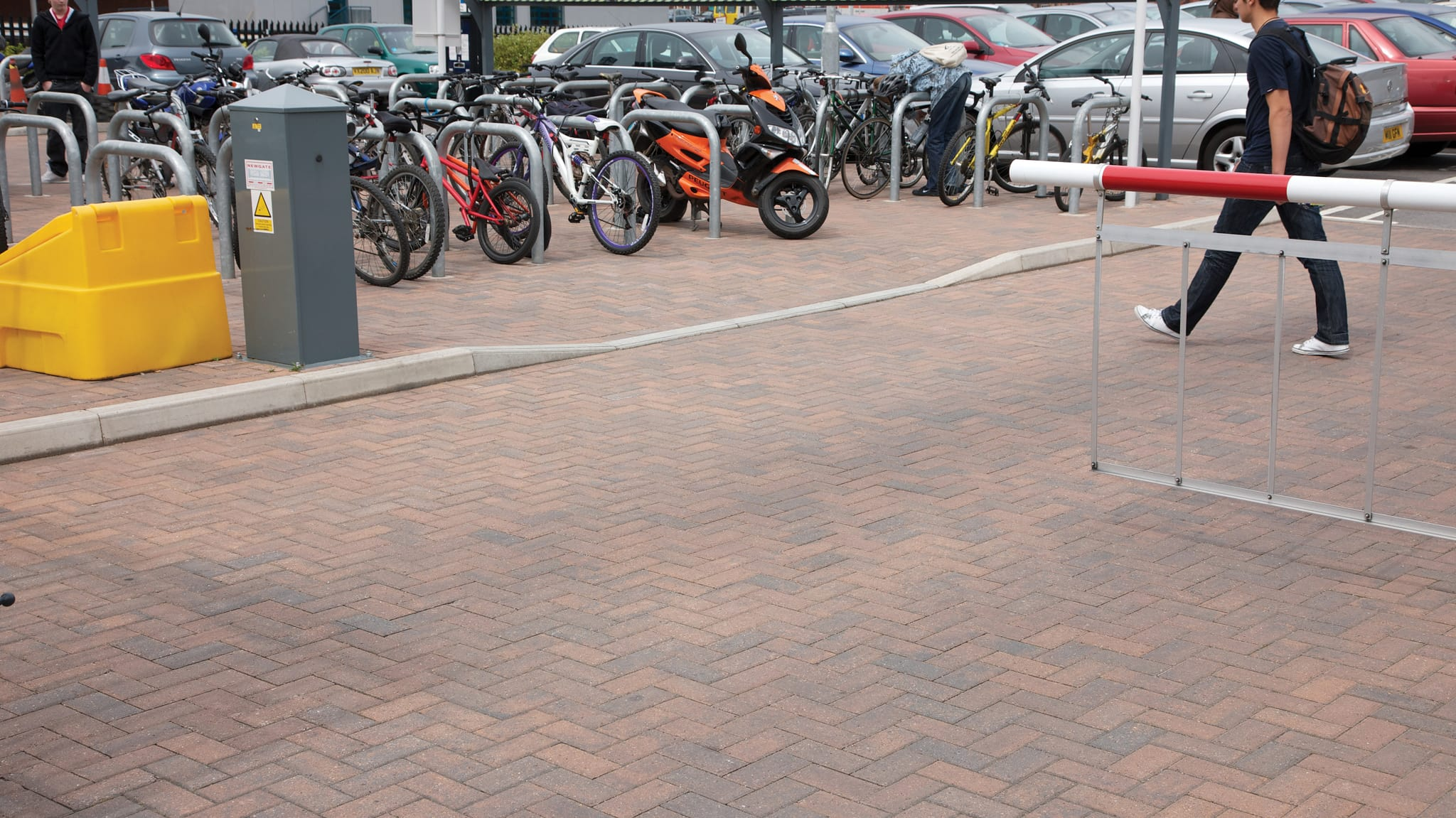 Brindle block paving inside car park.