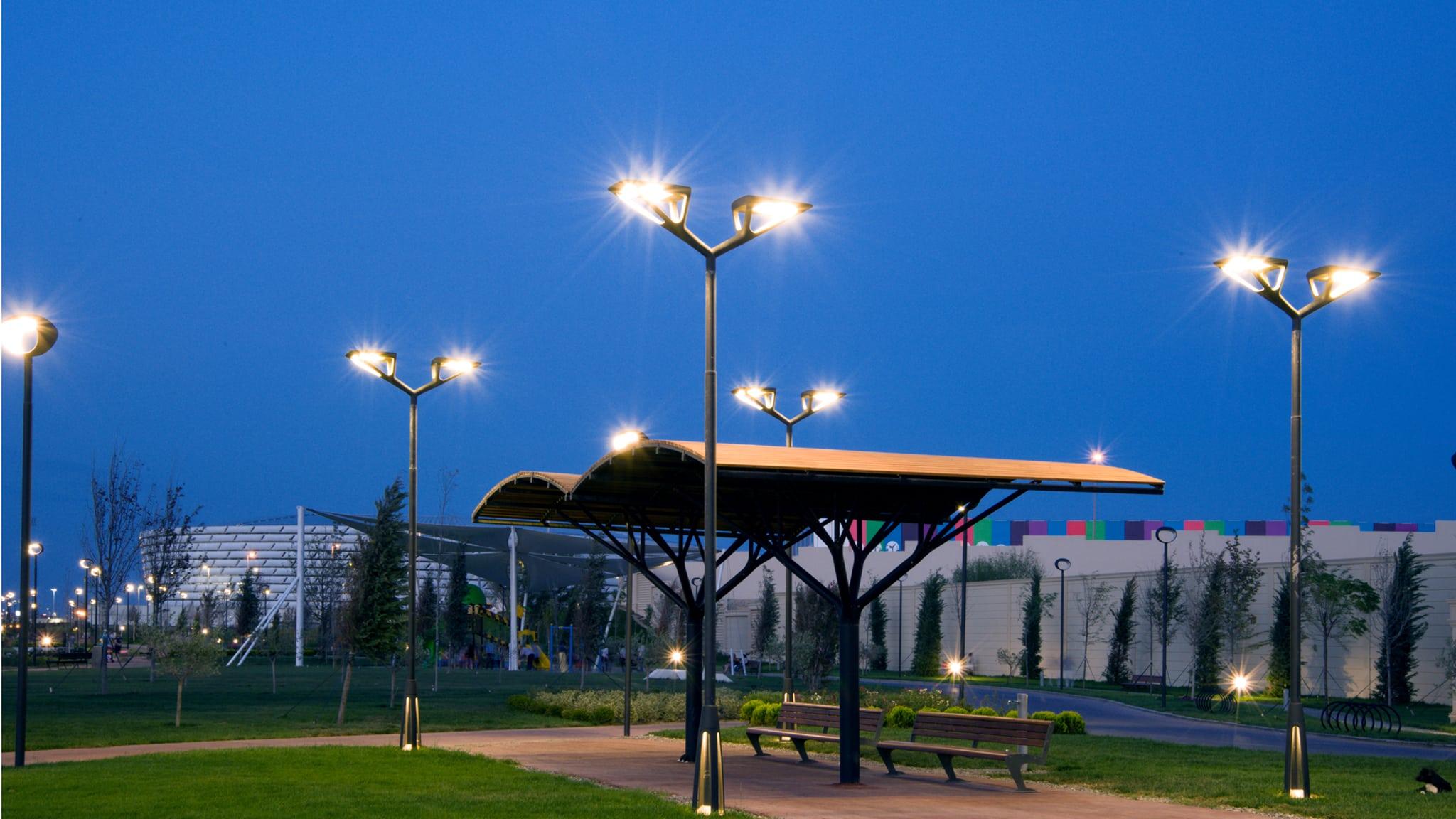 Light columns at night in public park