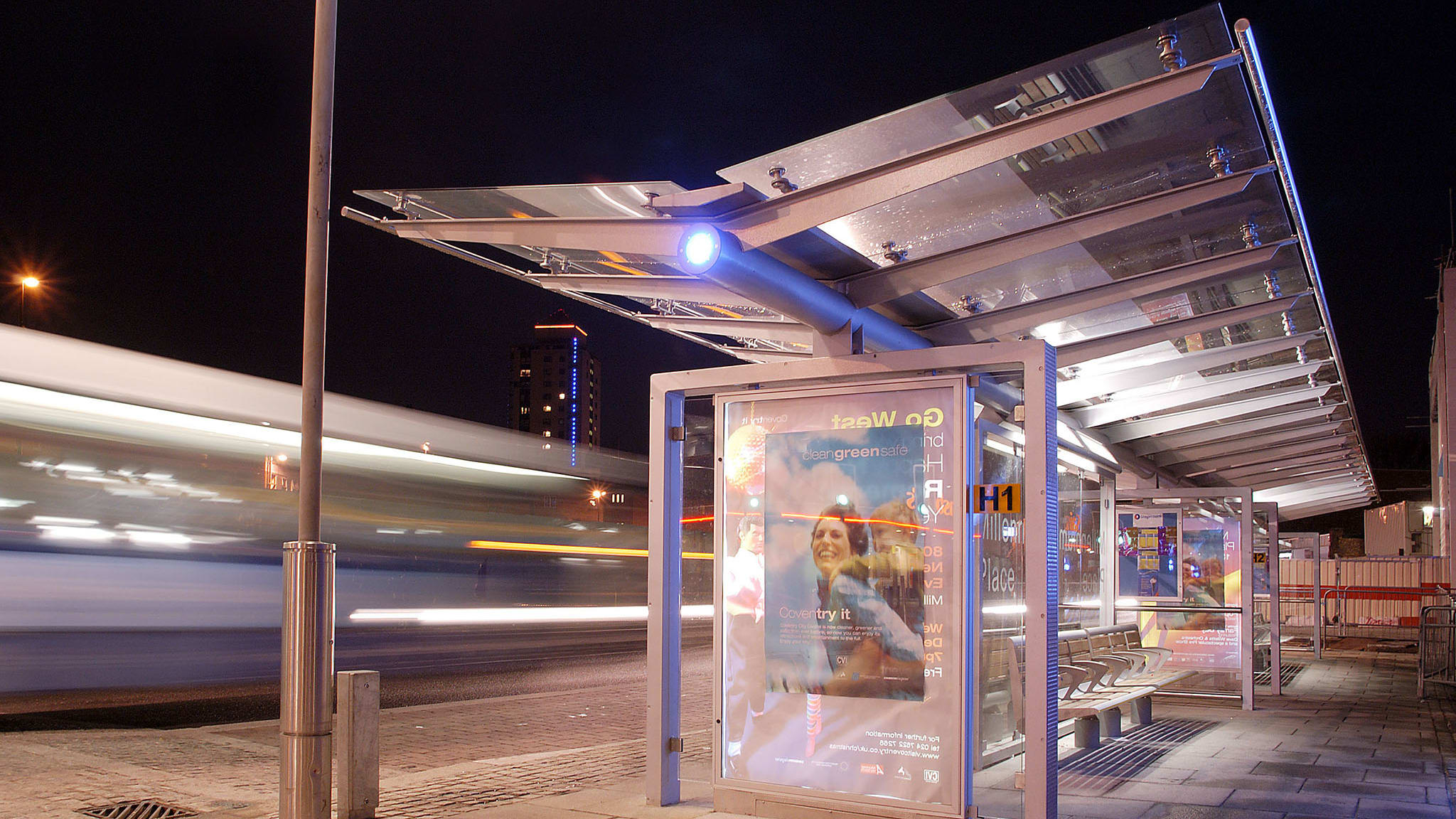 motis structires used as a bus stop lit up at night