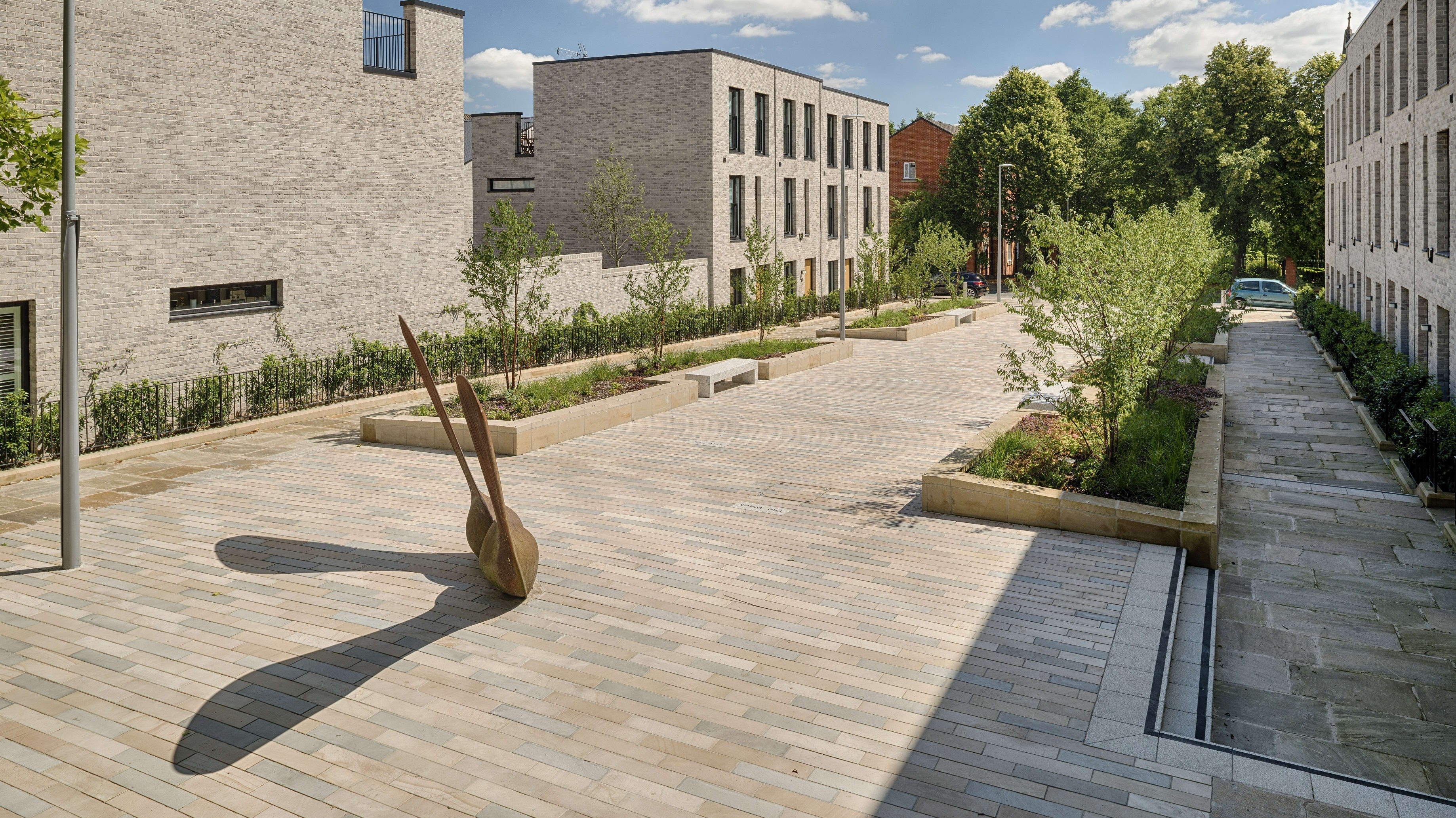 brackendale paving with flower beds