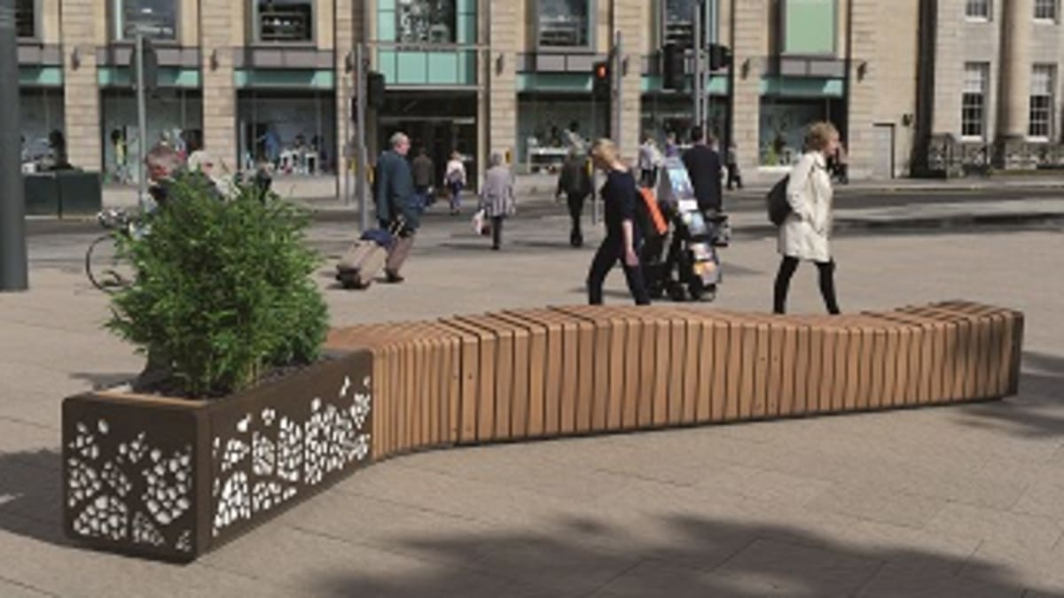 Natural Elements Bench Convex Module in front of shopping centre