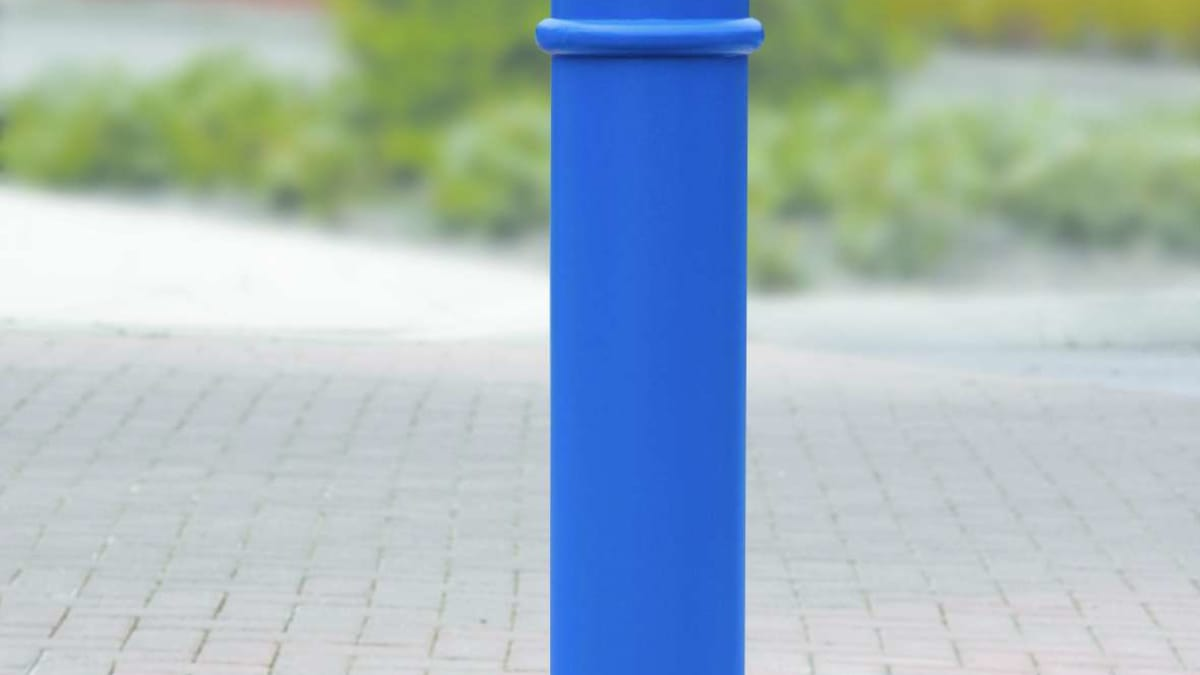 blue bollard on a pavement