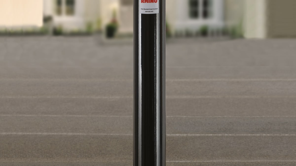 black bollard outside a building