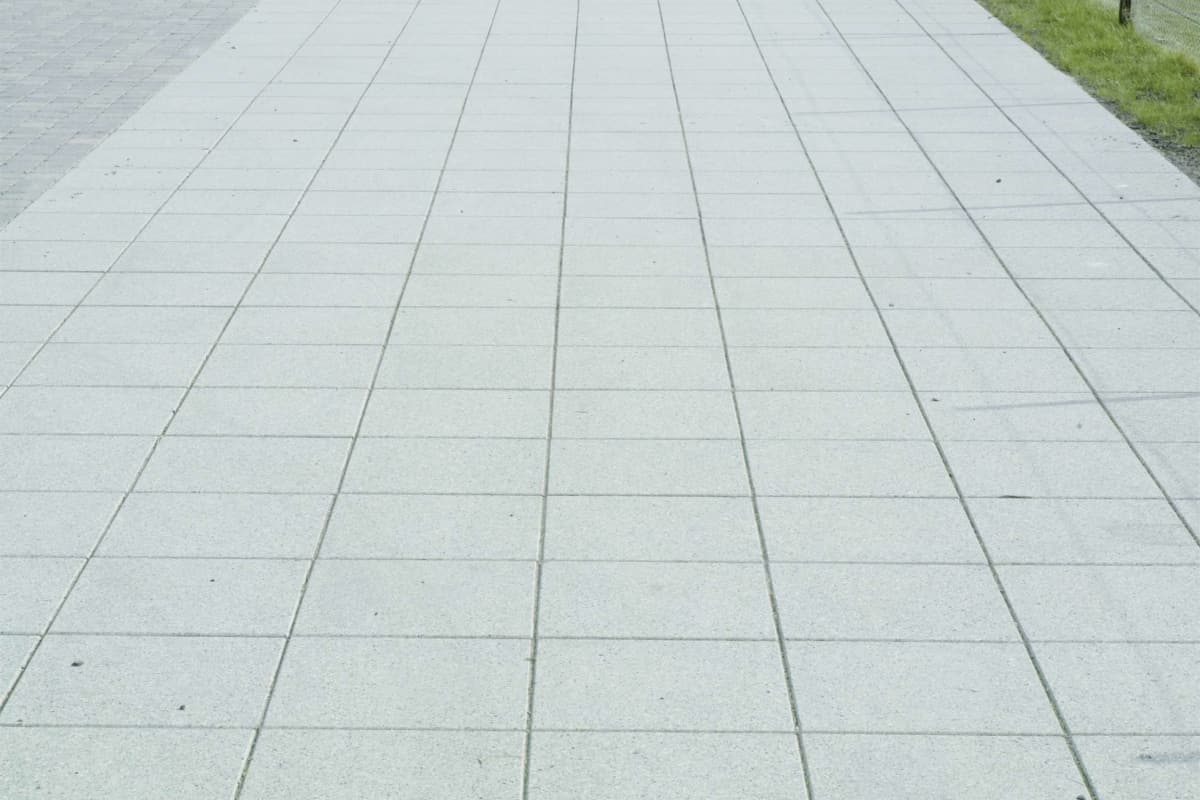 conservation - smooth ground silver grey and tegula - cobbles pennant grey dundee