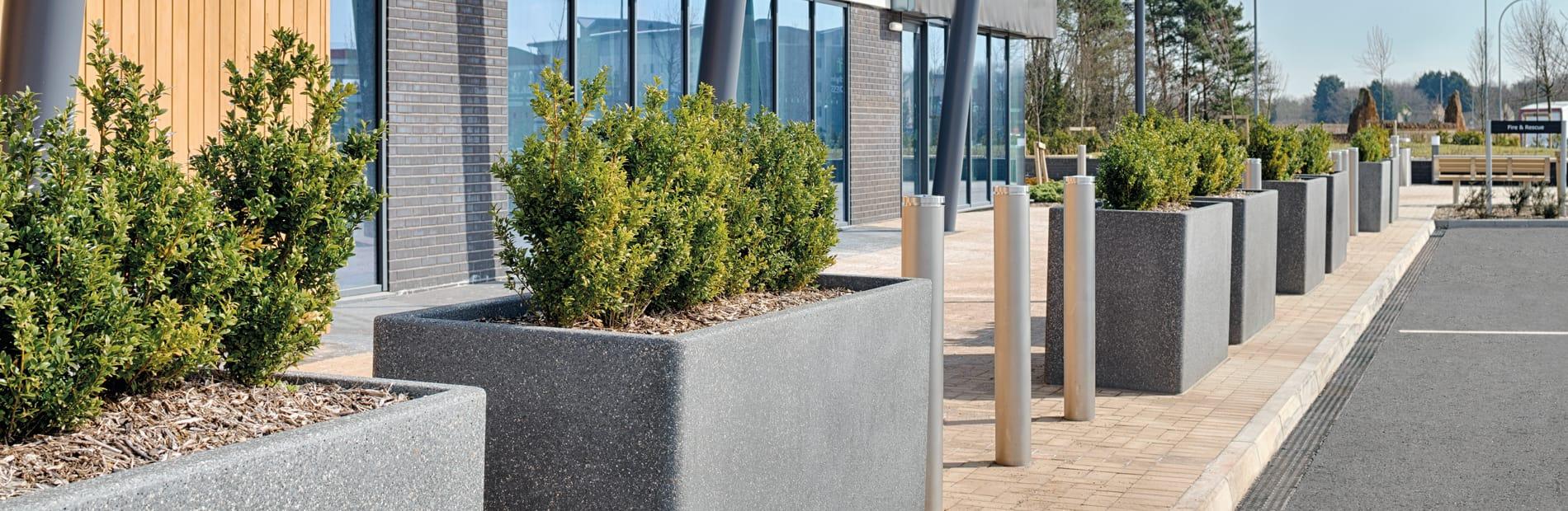 Grey Rhinoguard concrete palnters with Geo bollards