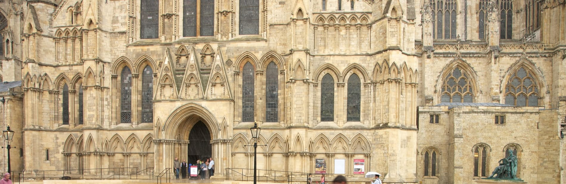 A couple walking infront of york cathedral.