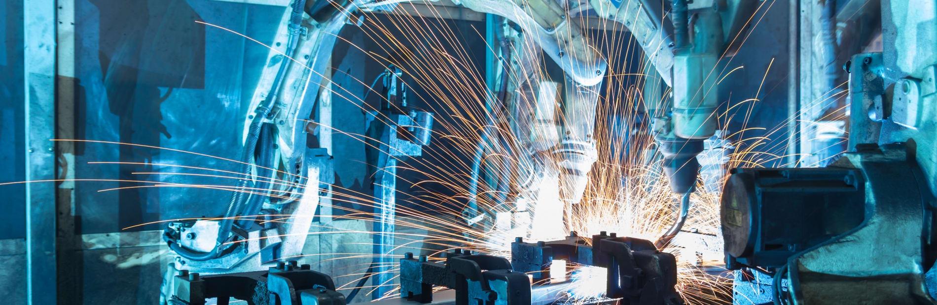 A large robot welding parts along a production line.