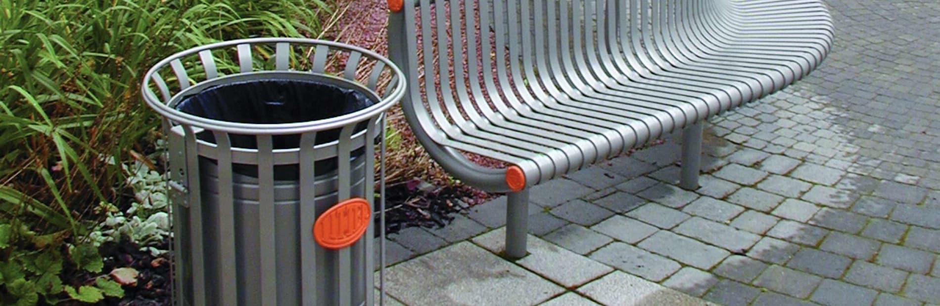 festival litter bin next to a bench