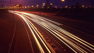 A timelapse of a busy motorway at night.