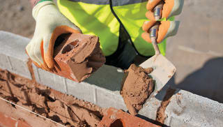 Mortar being used on bricks