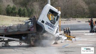 Wagon crashing into landscape protection.