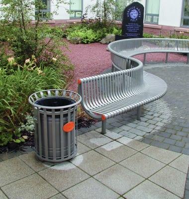 festival litter bin next to a bench