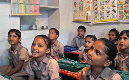 group of children learning in school