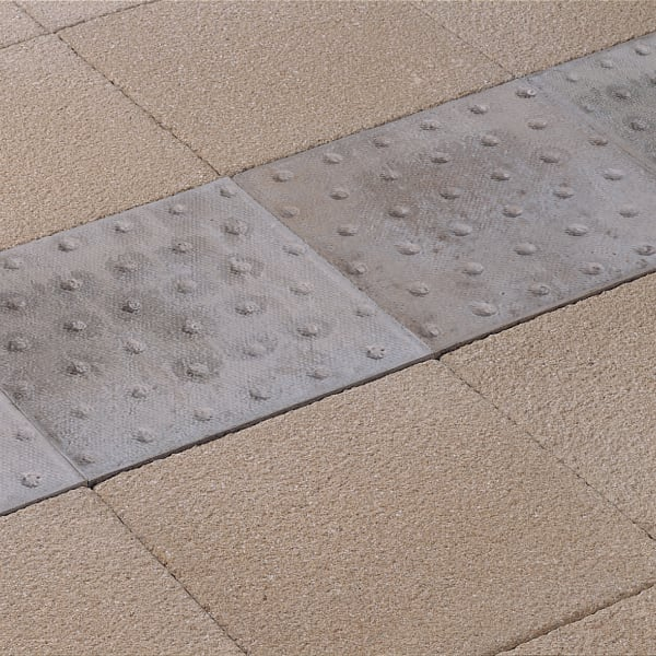 platform edge tactile flag paving - natural