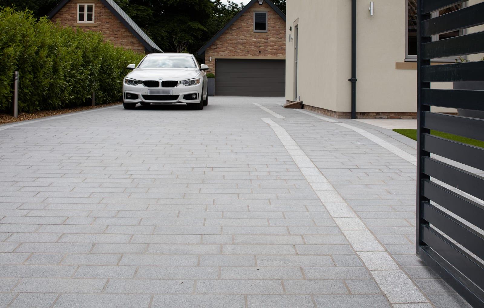 Sawn Granite Setts in Dark and Light driveway