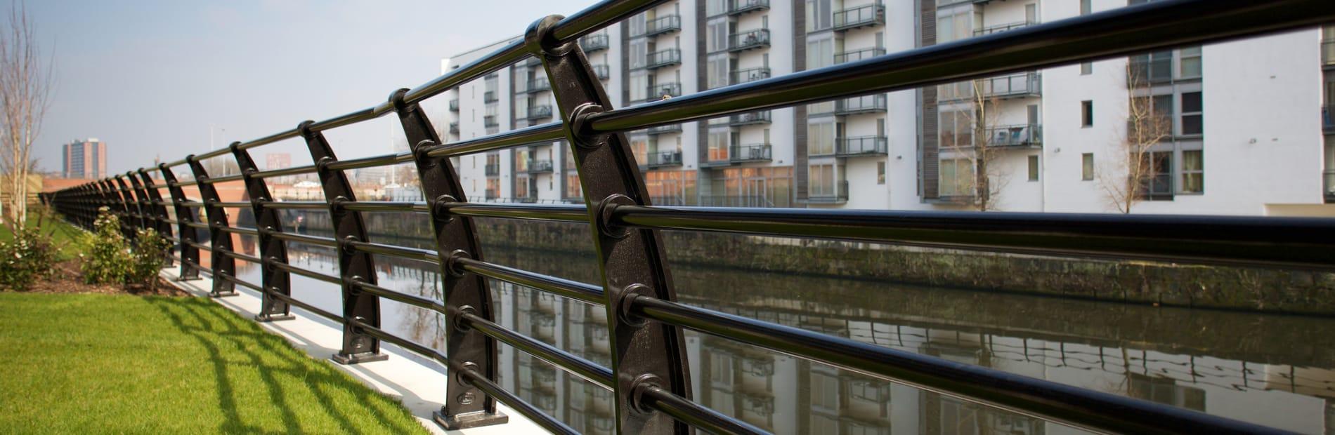Black railings outside apartment block.