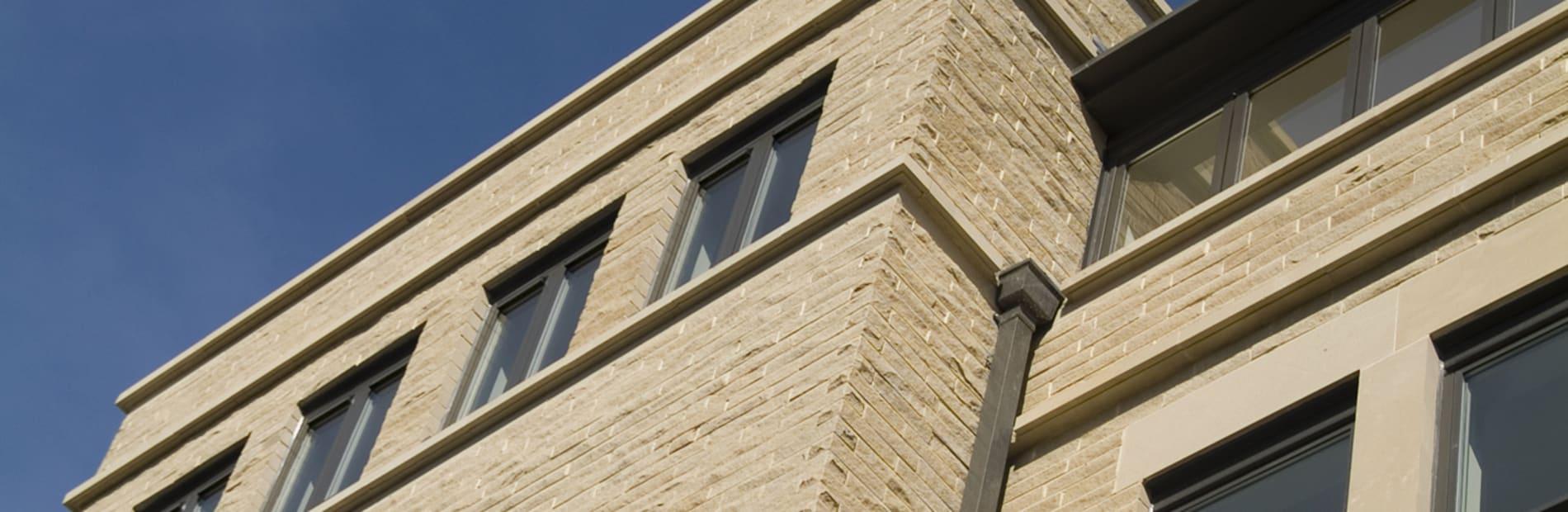 Split face sandstone walling