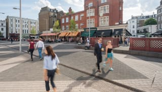 People walking in the high street.
