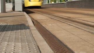 Yellow tram leaving the tram station.
