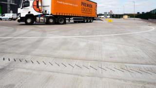 Truck next to Drexus XL drain in an industrial park.