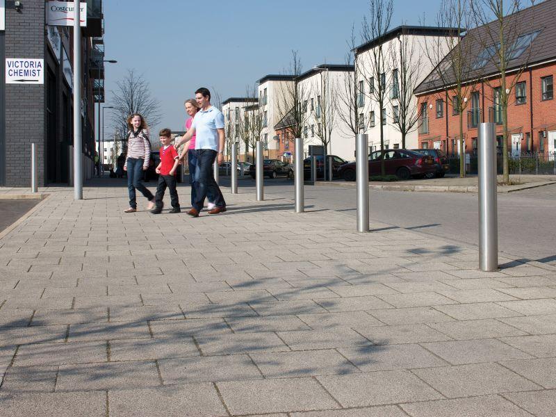 Family walking across neighbourhood