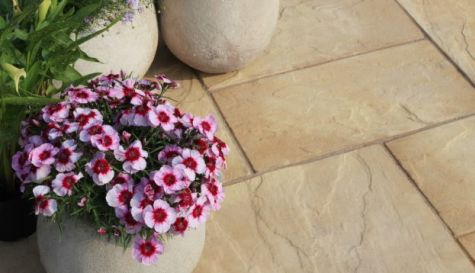 Natural coloured patio with bright plant pots