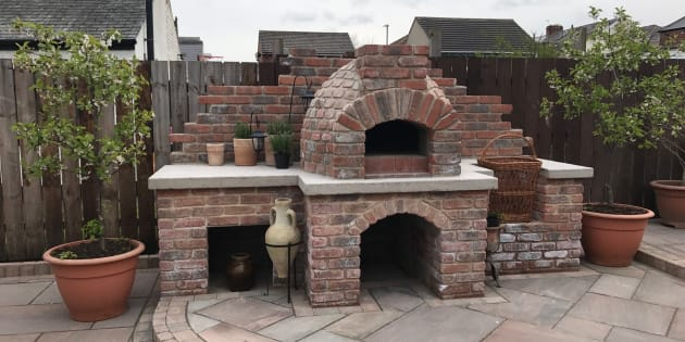 Brick built pizza oven with indian sandstone patio