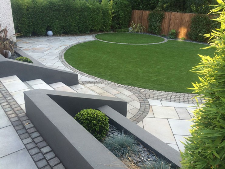 Grey paving used in a garden patio area
