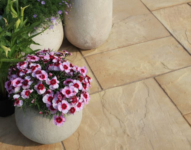 Flower pot placed on buff coloured paving