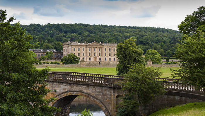 Chatsworth house next to a bridge