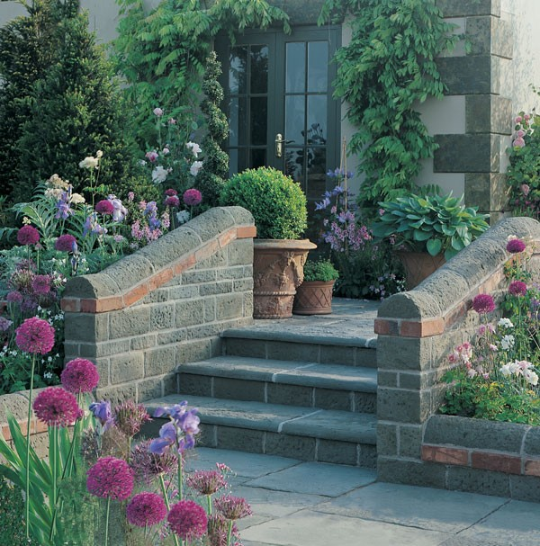 Garden planters placed at the top of a set of garden steps