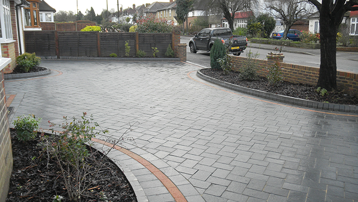 Dark grey paving laid for a driveway.