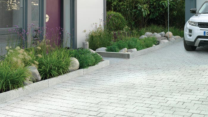 Light grey paving laid on a driveway.