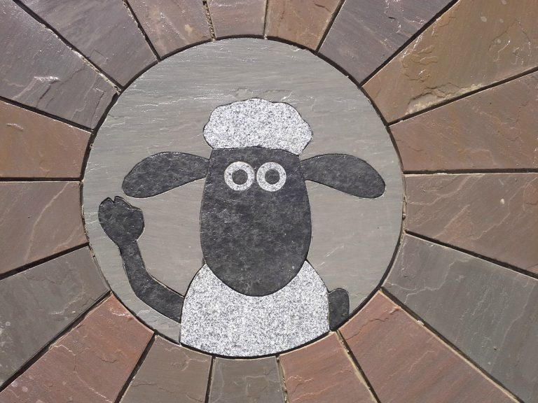 Shaun the Sheep engraved on paving.